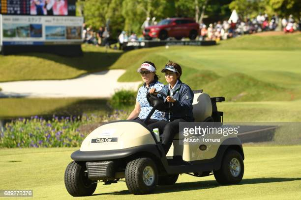 MiJeong Jeon of South Korea sits in golf cart as she is driven to the 18th tee for a playoff during the final round of the Resorttrust Ladies at the...