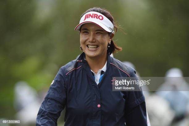 MiJeong Jeon of South Korea smiles as she walks off the course after play was suspended due to bad weather during the first round of the Yonex Ladies...