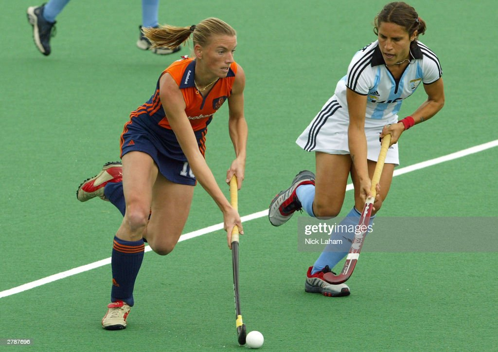 Mijntje Donners of the Netherlands runs the ball beside Mercedes Margalot of Argentina during the 2003 Women's BDO Hockey Champions Trophy match...