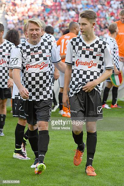 Mika Haekkinen and his son Hugo Haekkinen during the 'Champions for charity' football match between Nowitzki All Stars and Nazionale Piloti in honor...