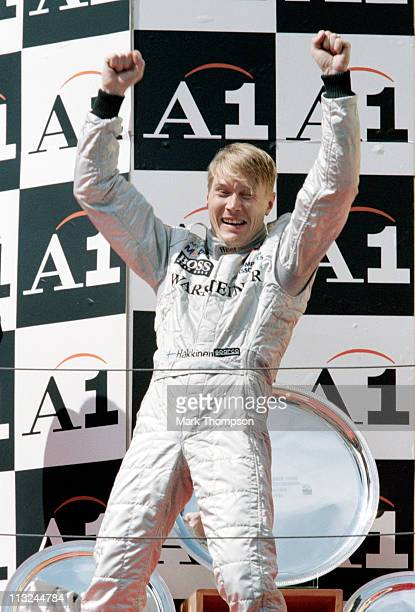 Mika Hakkinen driver of the West McLaren Mercedes McLaren MP413 Mercedes 30 V10 celebrates winning the Austrian Grand Prix on 26th July 1998 at the...