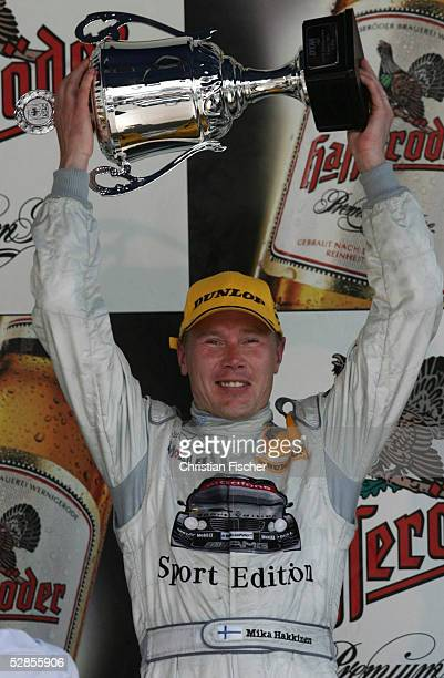 Mika Hakkinen of Finland and Mercedes lifts the third place trophy on the podium after Race 2 of the DTM 2005 German Touring Car Championship at the...