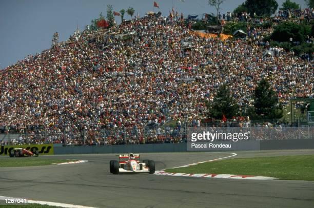 Mika Hakkinen of Finland cuts close to a corner in his McLaren Peugeot during the San Marino Grand Prix at the Imola circuit in San Marino Hakkinen...