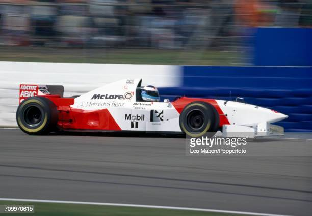 Mika Hakkinen of Finland in action driving a McLaren MP4/10B with a Mercedes FO 110F 30 V10 engine for Marlboro McLaren Mercedes during the British...