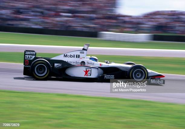 Mika Hakkinen of Finland in action driving a McLaren MP4/12 with a Mercedes FO 110F 30 V10 engine for West McLaren Mercedes during the British Grand...