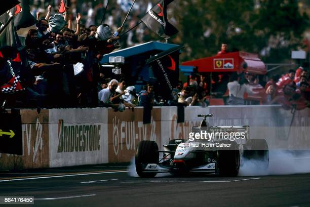 Mika Häkkinen McLarenMercedes MP413 Grand Prix of Japan Suzuka Circuit 01 November 1998 Mika Häkkinen locks his wheels in a cloud of smoke as he...