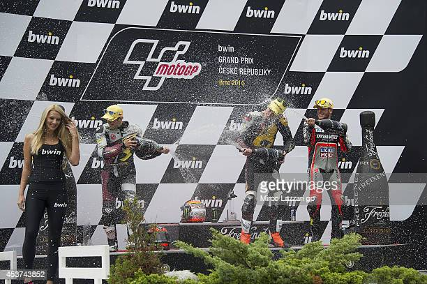 Mika Kallio of Finland and Marc VDS Racing Team Esteve Rabat of Spain and Marc VDS Racing Team and Sandro Cortese of Germany and Dynavolt Intact GP...