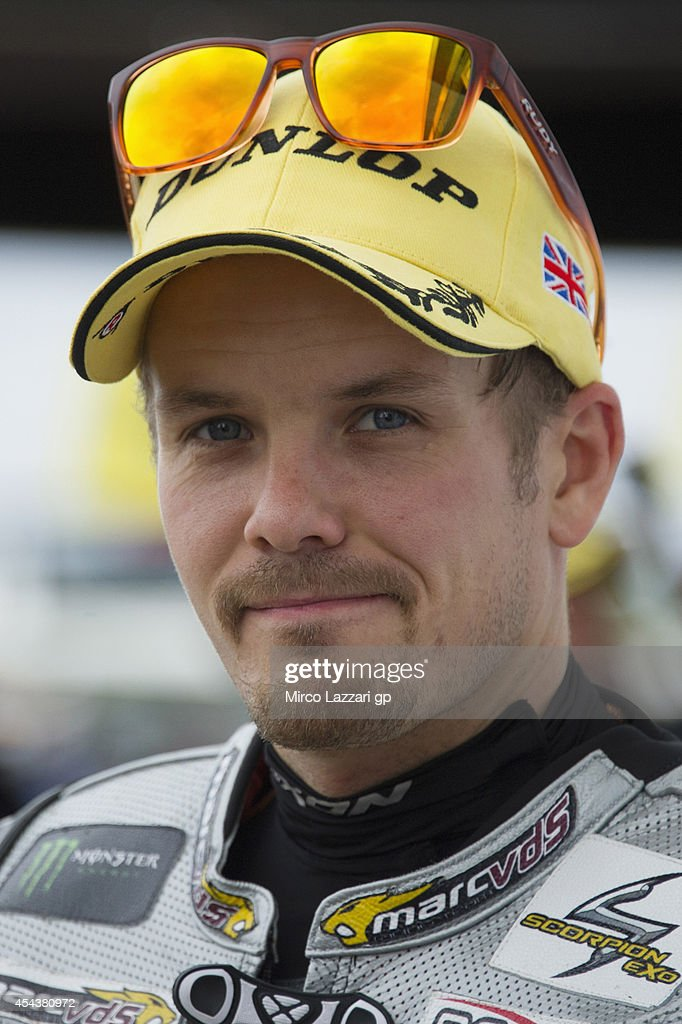 <a gi-track='captionPersonalityLinkClicked' href=/galleries/search?phrase=Mika+Kallio&family=editorial&specificpeople=543919 ng-click='$event.stopPropagation()'>Mika Kallio</a> of Finland and Marc VDS Racing Team smiles at the end of the qualifying practice during the MotoGp Of Great Britain - Qualifying at Silverstone Circuit on August 30, 2014 in Northampton, United Kingdom.