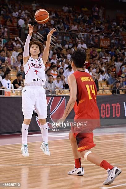 Mika Kurikara of Japan handles the ball while Sijing Huang of China in action in finals match between Japan and China during the 2015 FIBA Asia...