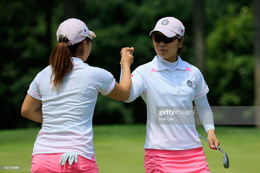 Mika Miyazato and Mamiko Higa of Japan celebrate on the 1st hole during round three of the International Crown at Caves Valley Golf Club on July 26...