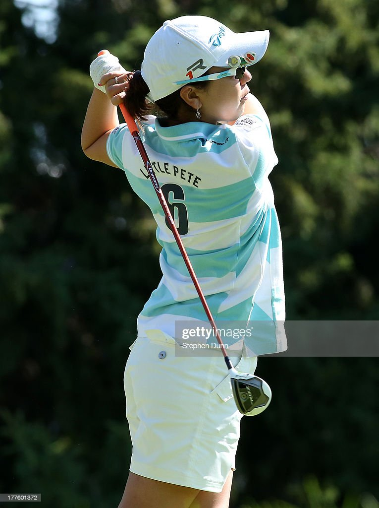 <a gi-track='captionPersonalityLinkClicked' href=/galleries/search?phrase=Mika+Miyazato&family=editorial&specificpeople=2646628 ng-click='$event.stopPropagation()'>Mika Miyazato</a> of Japan hits her tee shot on the 14th hole during the third round of the CN Canadian Women's Open at Royal Mayfair Golf Club on August 24, 2013 in Edmonton, Alberta, Canada.