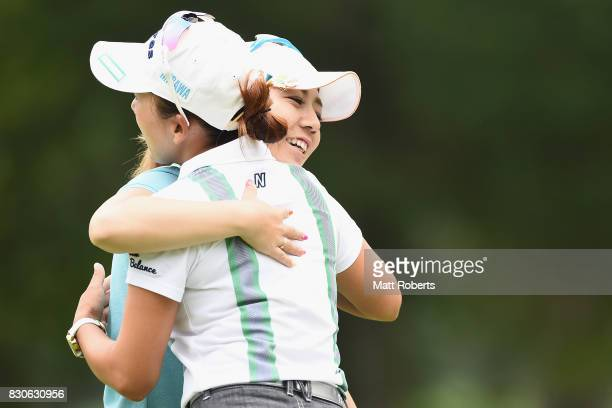 Mika Miyazato of Japan hugs Chie Arimura of Japan on the 18th green during the second round of the NEC Karuizawa 72 Golf Tournament 2017 at the...