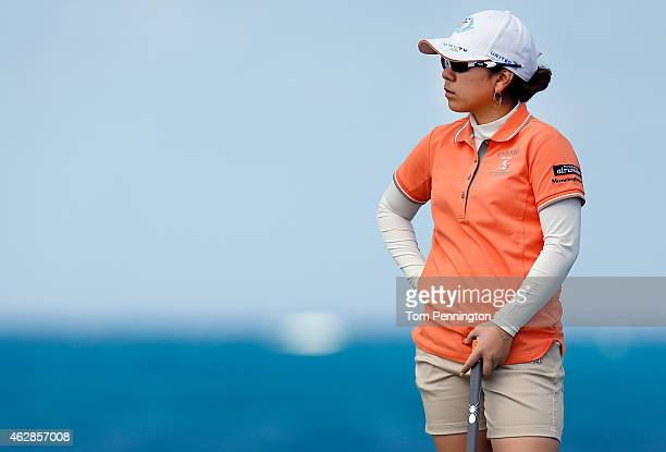 Mika Miyazato of Japan lines up a putt on the eighth green during round two of the Pure Silk Bahamas LPGA Classic at the Ocean Club course on...