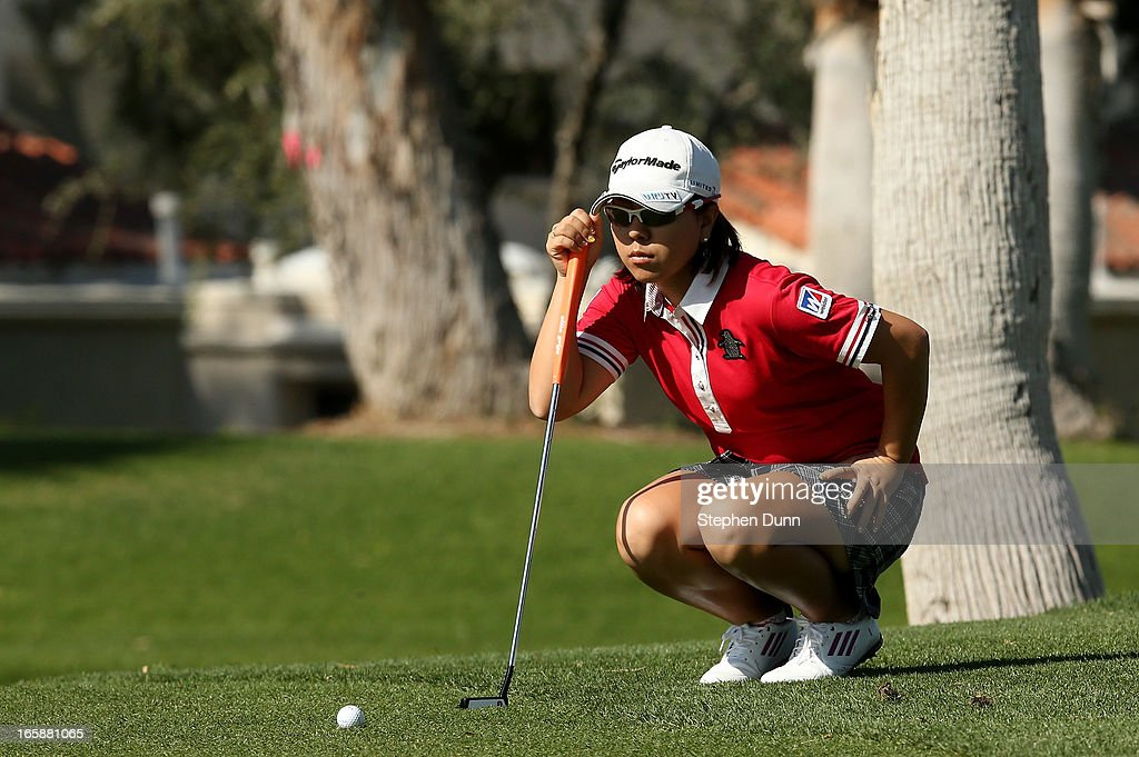 <a gi-track='captionPersonalityLinkClicked' href=/galleries/search?phrase=Mika+Miyazato&family=editorial&specificpeople=2646628 ng-click='$event.stopPropagation()'>Mika Miyazato</a> of Japan lines up a putt on the fifth hole during the third round of the Kraft Nabisco Championship at Mission Hills Country Club on April 6, 2013 in Rancho Mirage, California.