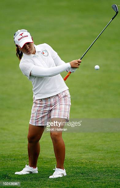 Mika Miyazato of Japan plays a pitch shot on the 18th hole during the third round of the LPGA Championship presented by Wegman's 2010 at the Locust...