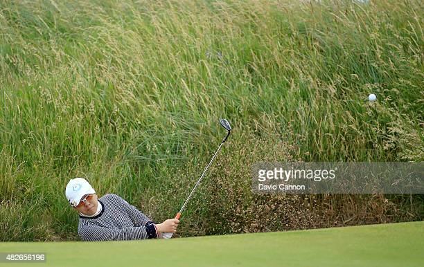Mika Miyazato of Japan plays her second shot at the par 3 15th hole during the third round of the 2015 Ricoh Women's British Open on the Ailsa Course...