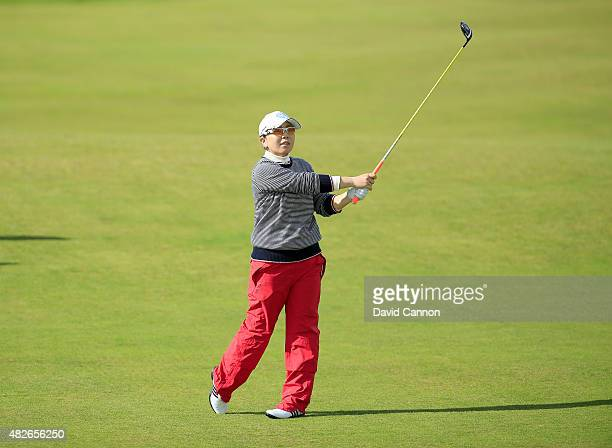 Mika Miyazato of Japan plays her second shot at the par 5 17th hole during the third round of the 2015 Ricoh Women's British Open on the Ailsa Course...