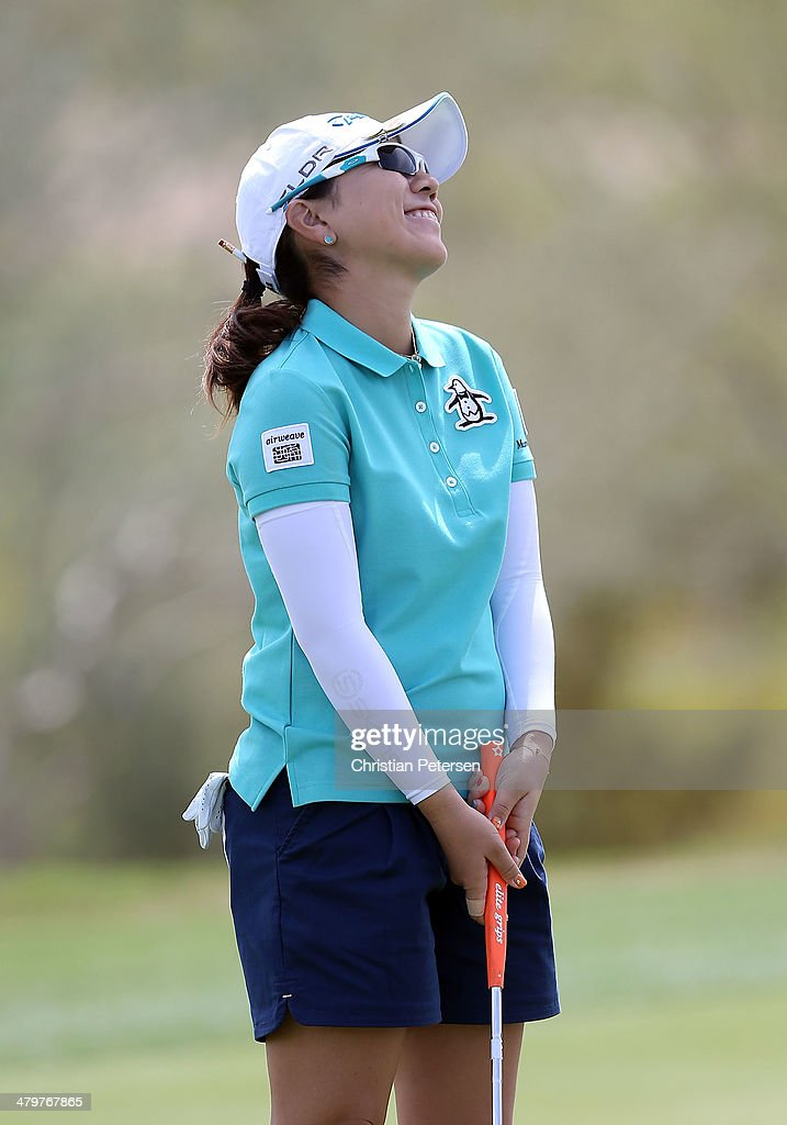 Mika Miyazato of Japan reacts to a missed putt on the 18th green during the first round of the JTBC LPGA Founders Cup at Wildfire Golf Club on March 20, 2014 in Phoenix, Arizona.
