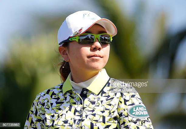 Mika Miyazato of Japan walks down the fourth hole during the first round of the Pure Silk Bahamas LPGA Classic at the Ocean Club Golf Course on...