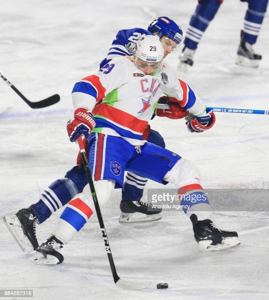 Mika Niemi of Jokerit Helsinki in action against Ilya Kablukov of SKA during the KHL Hockey match between Jokerit and SKA at Kaisaniemen park in...