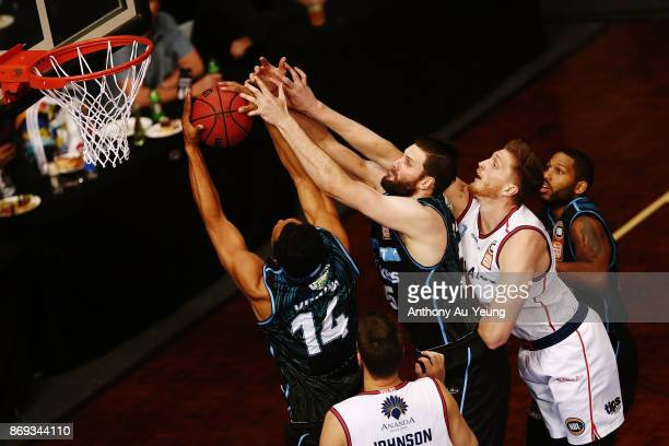 Mika Vukona and Alex Pledger of the Breakers compete for the rebound against Matt Hodgson of the 36ers during the round five NBL match between the...
