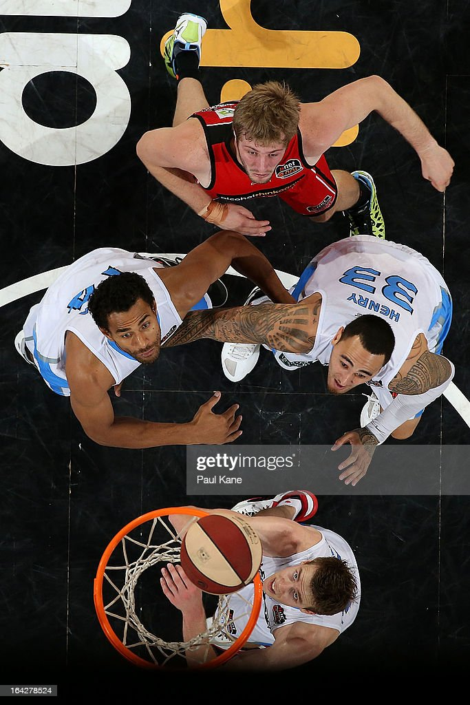 Mika Vukona, Leon Henry and Tom Abercrombie of the Breakers contest arebound against Jesse Wagstaff of the Wildcats during the round 24 NBL match between the Perth Wildcats and the New Zealand Breakers at Perth Arena on March 22, 2013 in Perth, Australia.