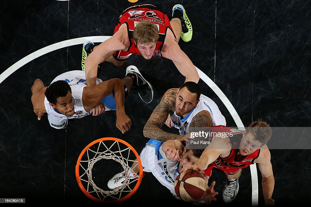 Mika Vukona, Leon Henry and Tom Abercrombie of the Breakers contest arebound against Jesse Wagstaff and Cameron Tovey of the Wildcats during the round 24 NBL match between the Perth Wildcats and the New Zealand Breakers at Perth Arena on March 22, 2013 in Perth, Australia.