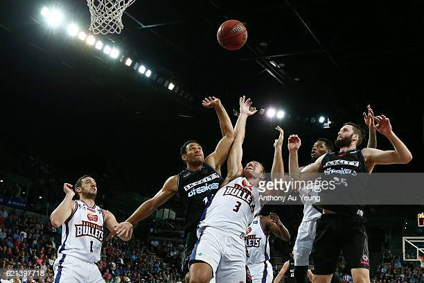 Mika Vukona of New Zealand competes for the rebound against Mitchell Young of Brisbane during the round five NBL match between the New Zealand...