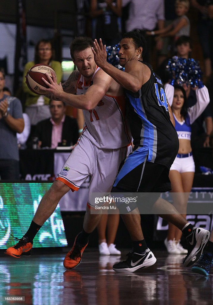 Mika Vukona of the Breakers (R) blocks Cameron Tragardh of the Titans during the round 22 NBL match between the New Zealand Breakers and the Cairns Taipans at North Shore Events Centre on March 7, 2013 in Auckland, New Zealand.