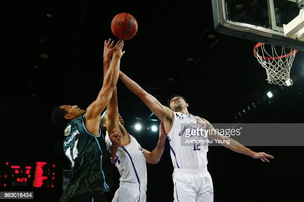 Mika Vukona of the Breakers competes for a rebound against Todd Blanchfield and Perry Ellis of the Kings during the round three NBL match between the...