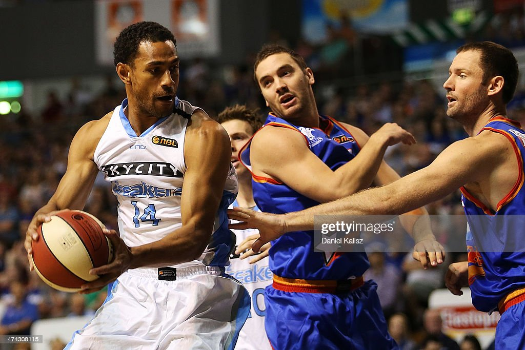 Mika Vukona (L) of the Breakers contests for the ball with Adam Gibson of the Sixers during the round 19 NBL match between the Adelaide 36ers and the New Zealand Breakers at Adelaide Arena in February 23, 2014 in Adelaide, Australia.