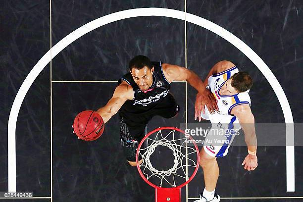 Mika Vukona of the Breakers scores against Daniel Kickert of the Bullets during the round 10 NBL match between the New Zealand Breakers and the...