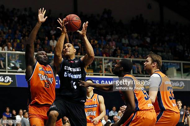 Mika Vukona of the Breakers scores against Nathan Jawai of the Taipans during the round 17 NBL match between the New Zealand Breakers and the Cairns...