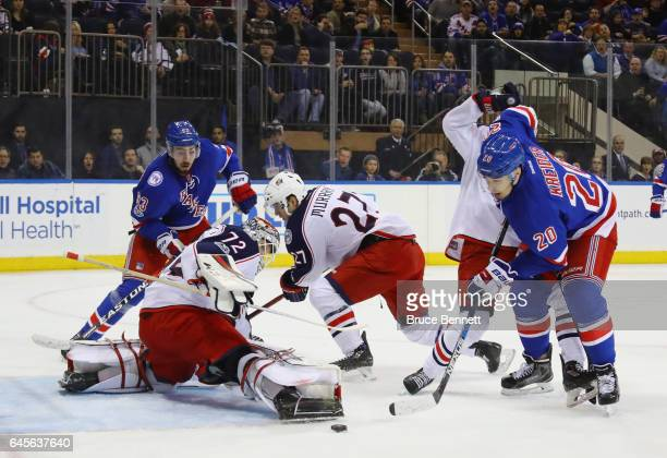 Mika Zibanejad and Michael Grabner of the New York Rangers converge on Sergei Bobrovsky of the Columbus Blue Jackets during the second period at...