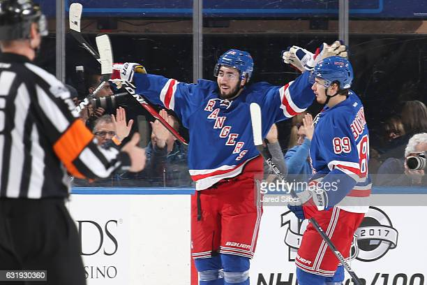 Mika Zibanejad and Pavel Buchnevich of the New York Rangers celebrate after scoring a goal in the second period against the Dallas Stars at Madison...
