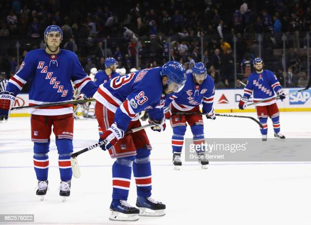 Mika Zibanejad and the New York Rangers leave the ice following a 54 defeat against the Pittsburgh Penguins at Madison Square Garden on October 17...
