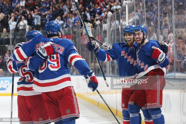 Mika Zibanejad Chris Kreider Pavel Buchnevich and Mats Zuccarello of the New York Rangers celebrate after scoring a goal in the first period against...