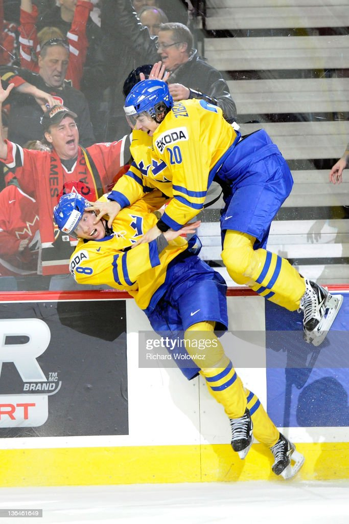 Mika Zibanejad #20 of Team Sweden celebrates his overtime goal against Team Russia with teammate Petter Granberg #8 during the 2012 World Junior Hockey Championship Gold Medal game at the Scotiabank Saddledome on January 5, 2012 in Calgary, Alberta, Canada. Team Sweden defeated Team Russia 1-0 in overtime.