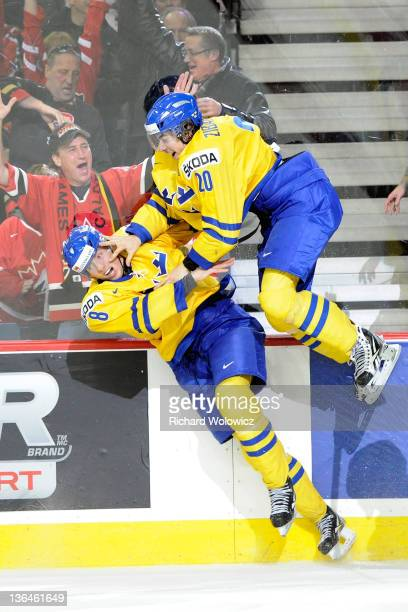 Mika Zibanejad of Team Sweden celebrates his overtime goal against Team Russia with teammate Petter Granberg during the 2012 World Junior Hockey...