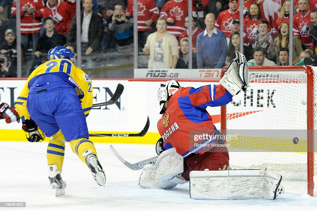 Mika Zibanejad #20 of Team Sweden shoots the puck past Andrei Makarov #20 of Team Russia to win during the 2012 World Junior Hockey Championship Gold Medal game in overtime at the Scotiabank Saddledome on January 5, 2012 in Calgary, Alberta, Canada. Team Sweden defeated Team Russia 1-0 in overtime.