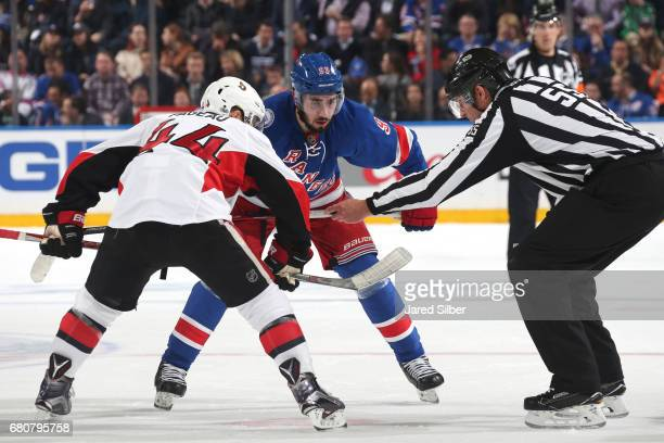 Mika Zibanejad of the New York Rangers and JeanGabriel Pageau of the Ottawa Senators line up for a faceoff in Game Four of the Eastern Conference...