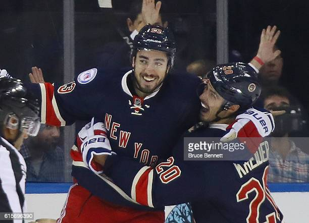 Mika Zibanejad of the New York Rangers celebrates his first period goal against the Detroit Red Wings and is joined by Chris Kreider at Madison...