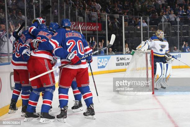 Mika Zibanejad of the New York Rangers celebrates his first period goal with Chris Kreider Pavel Buchnevich and Mats Zuccarello against Carter Hutton...