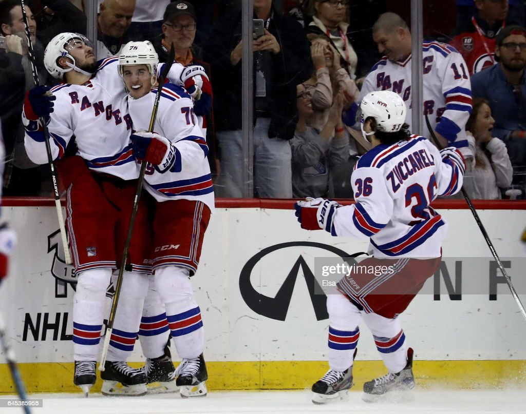 Mika Zibanejad #93 of the New York Rangers celebrates his game winning goal with teammates Brady Skjei #76 and Mats Zuccarello #36in overime against the New Jersey Devils on February 25, 2017 at Prudential Center in Newark, New Jersey.The New York Rangers defeated the New Jersey Devils 4-3 n overtime.