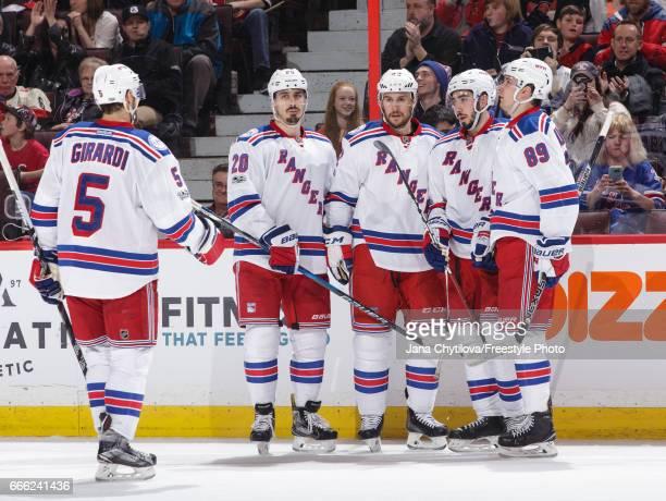 Mika Zibanejad of the New York Rangers celebrates his late third period goal against the Ottawa Senators with team mates Dan Girardi Chris Kreider...