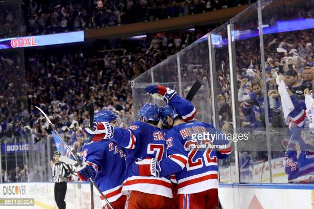 Mika Zibanejad of the New York Rangers celebrates with his teammates after scoring a goal against Craig Anderson of the Ottawa Senators during the...