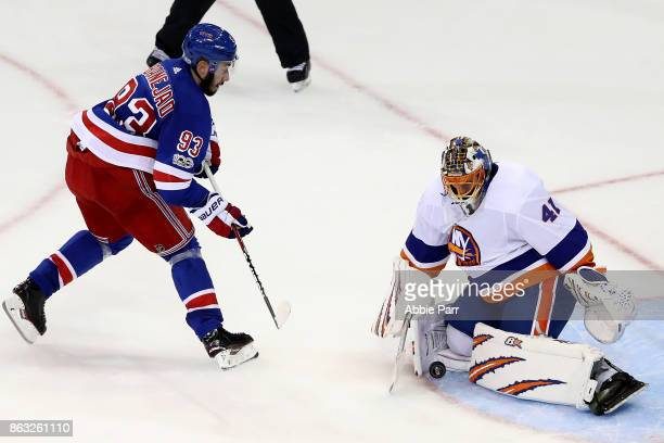 Mika Zibanejad of the New York Rangers has his shot blocked by Jaroslav Halak of the New York Islanders during their overtime shoot out at Madison...