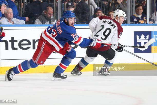 Mika Zibanejad of the New York Rangers passes the puck against Nathan MacKinnon of the Colorado Avalanche at Madison Square Garden on October 5 2017...