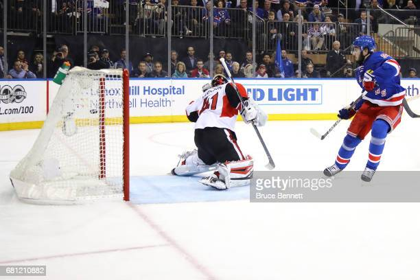 Mika Zibanejad of the New York Rangers scores a goal against Craig Anderson of the Ottawa Senators during the second period in Game Six of the...