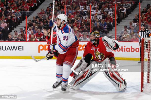 Mika Zibanejad of the New York Rangers screens Craig Anderson of the Ottawa Senators in Game Two of the Eastern Conference Second Round during the...